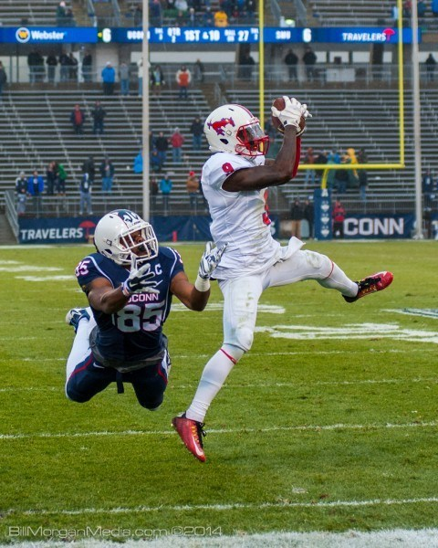 SMU Mustangs' Shelby Walker grabs an easy pass for their second touchdown of the day against the UCONN Huskies.