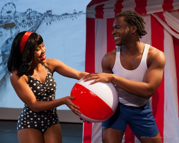 two dancers playing with a beachball